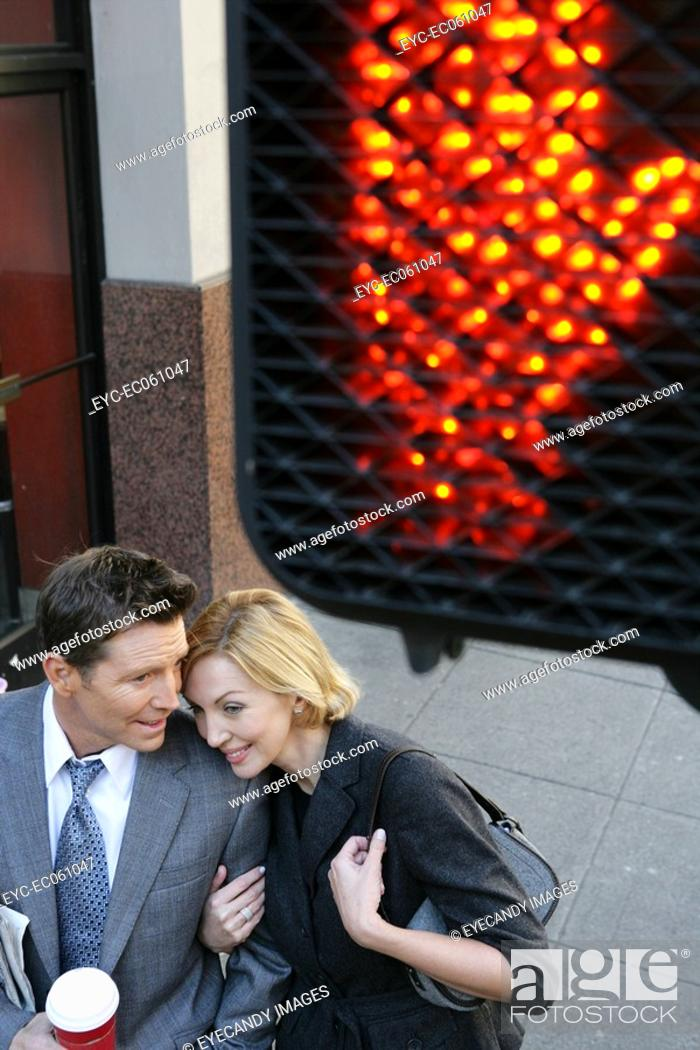 Stock Photo: Aerial view of couple near a walk sign.