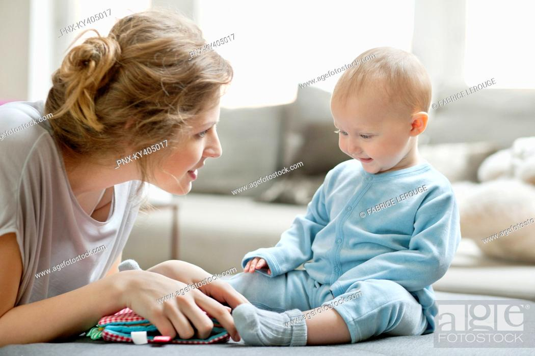 Stock Photo: Woman playing with her daughter.