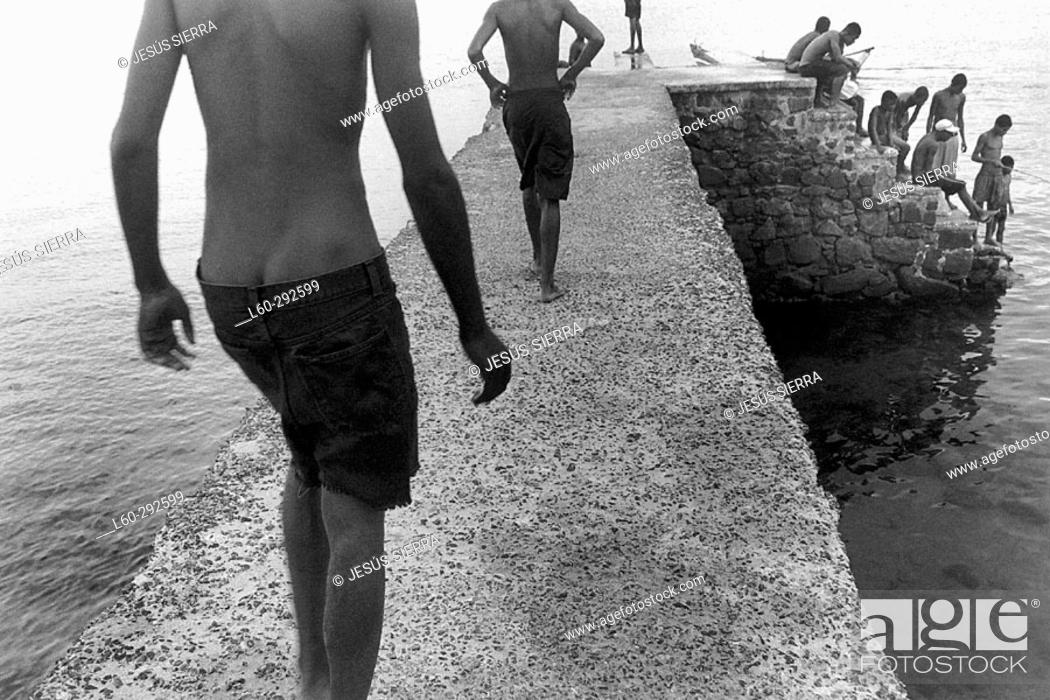 Stock Photo: Young people at Porto da Barra. Salvador da Bahia. Brazil.