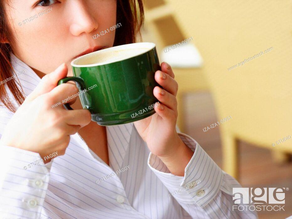 Stock Photo: Portrait of a businesswoman drinking coffee.