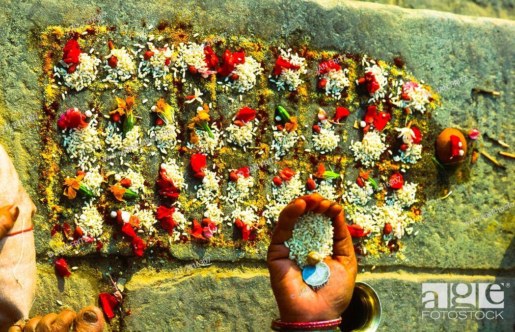 Stock Photo: ritual at Ganga riverbank in varanasi, india.