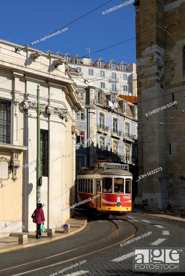 Stock Photo: tramway in front of the Cathedral of St Mary Major in Alfama district, lisbon, portugal, europe.
