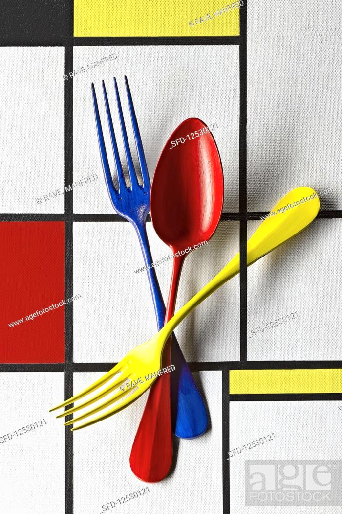 Stock Photo: Food art: colourful cutlery (inspired by Piet Mondrian).