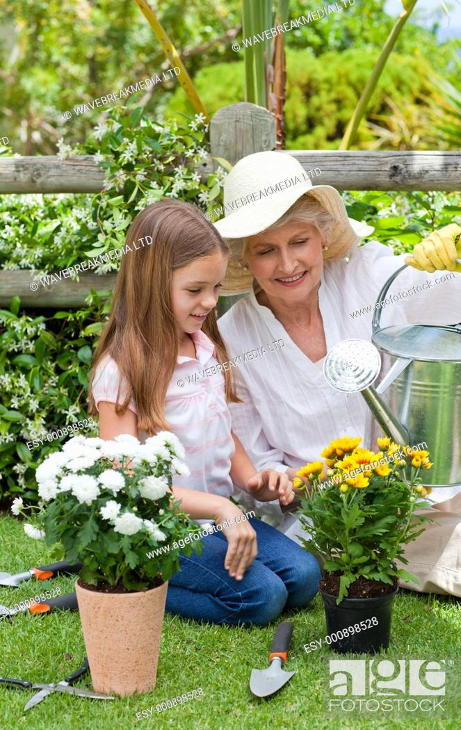 Stock Photo: Grandmother with her granddaughter working in the garden.