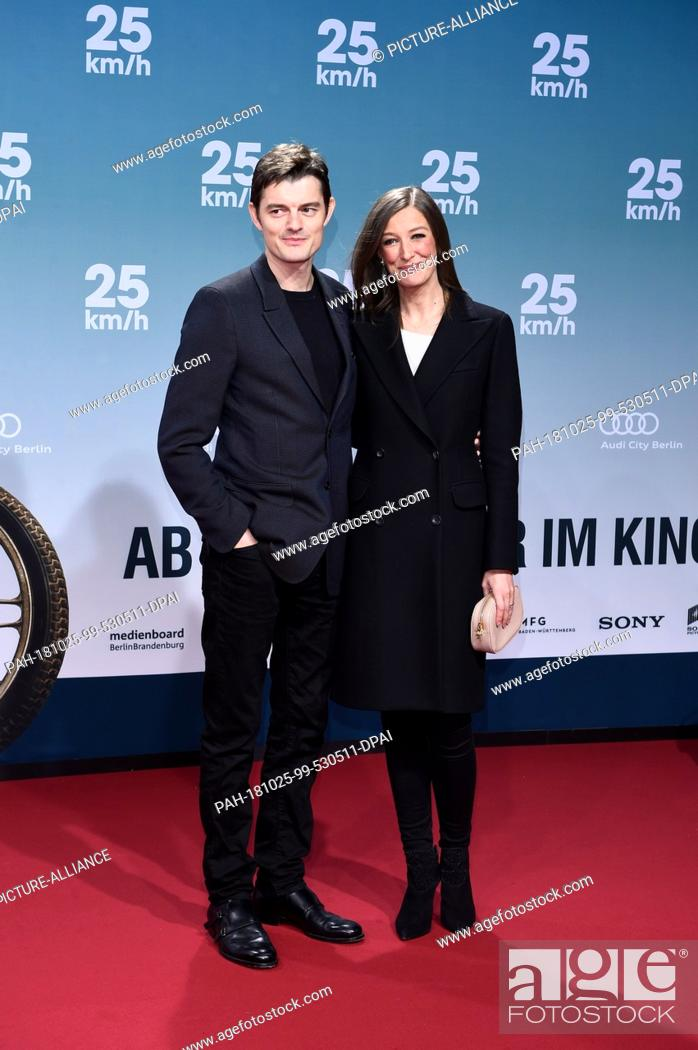 25 October 2018, Berlin: Sam Riley (l), actor, and his wife