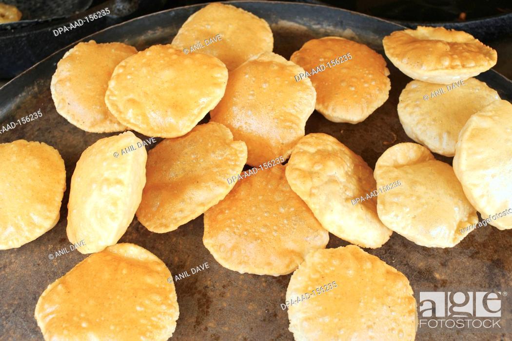 Stock Photo: Breakfast ; puries ; Kushi Nagar ; Uttar Pradesh ; India.