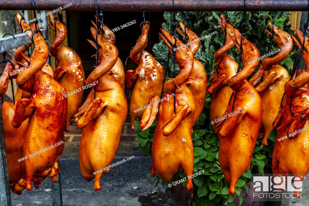 Stock Photo: Cooked Ducks Hanging From A Rack In The Street, Phnom Penh, Cambodia.