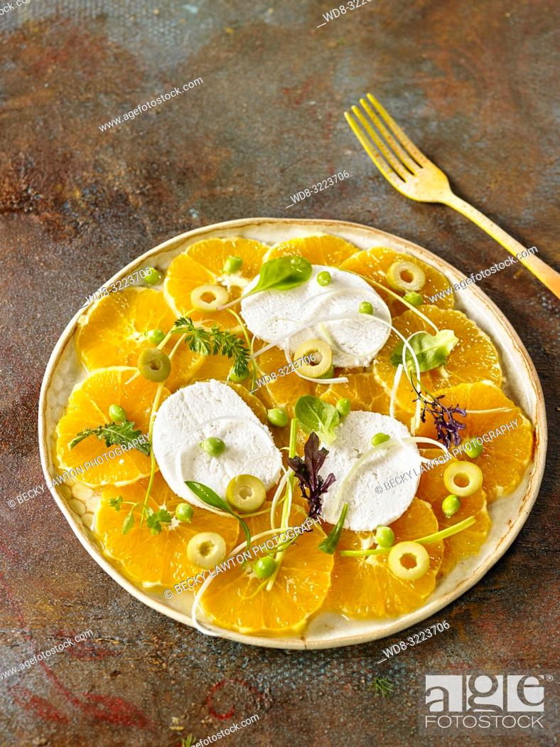 Stock Photo: ensalada de naranjas, queso y nuez de macadamia / salad of oranges, cheese and macadamia nut.