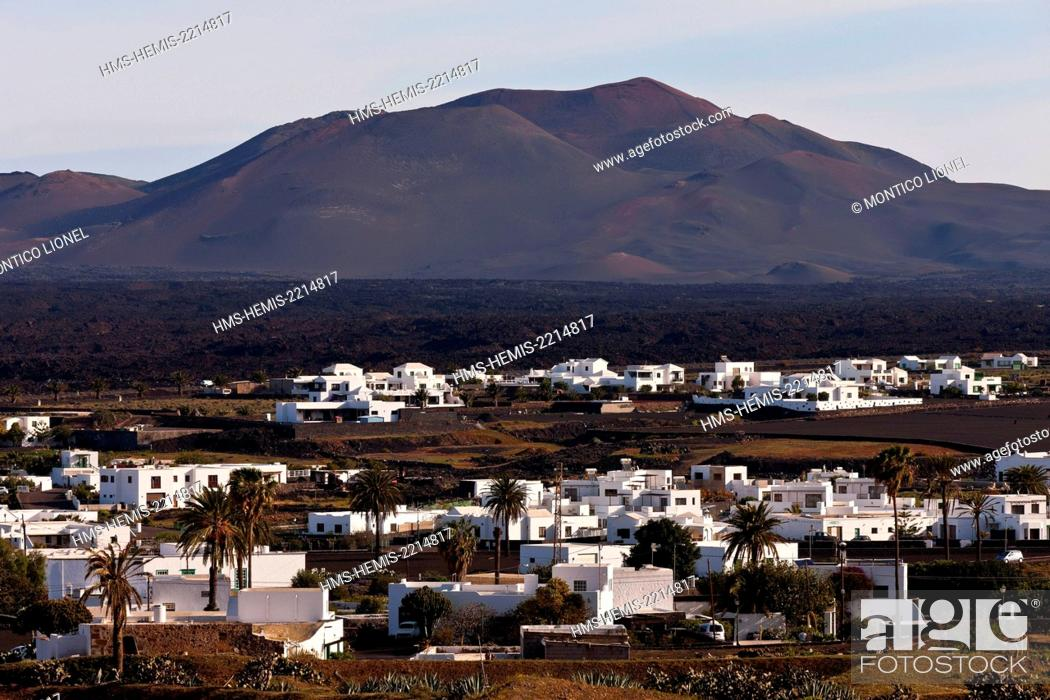 Stock Photo: Spain, Canaries Islands, Lanzarote island, the village of Yaiza and the parc national of Timanfaya.