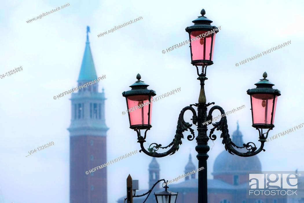 Stock Photo: Close up of lantern and campanile in Venice, Italy, Europe.