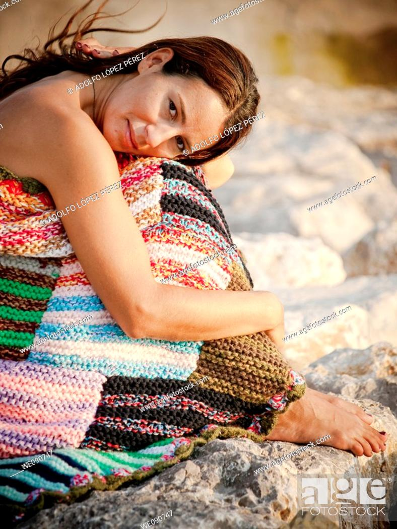 Stock Photo: Woman with blanket in the evening.