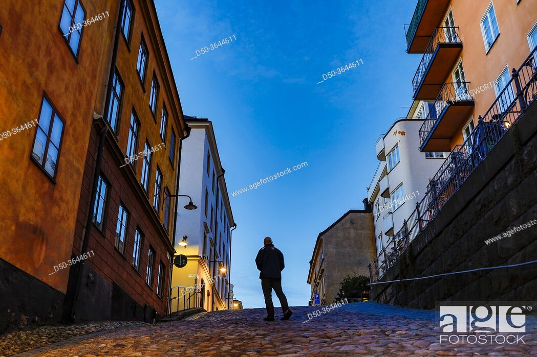 Stock Photo: Stockholm, Sweden A man walking on the historic Bellmansgatan in the early morning.