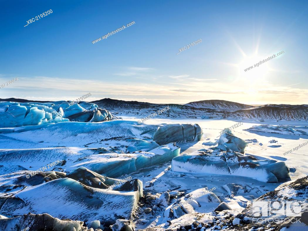 Stock Photo: Svinafellsjoekull glacier in Vatnajoekull NP during Winter, view over the frozen glacial lake and the melting glacial front.