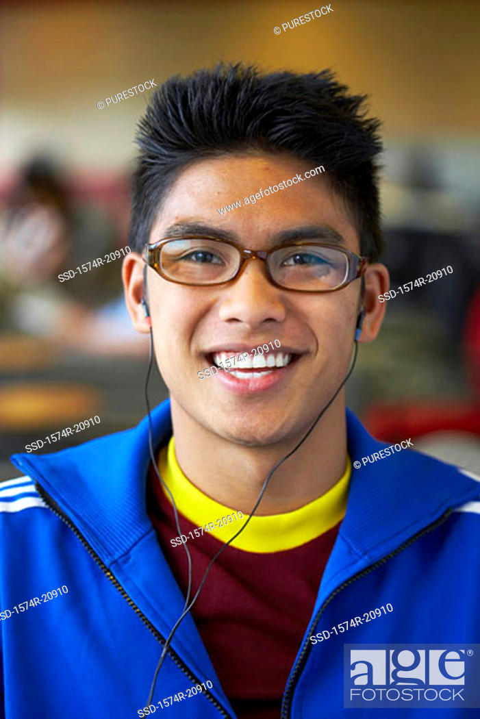 Stock Photo: Portrait of a college student wearing headphones and listening to music.