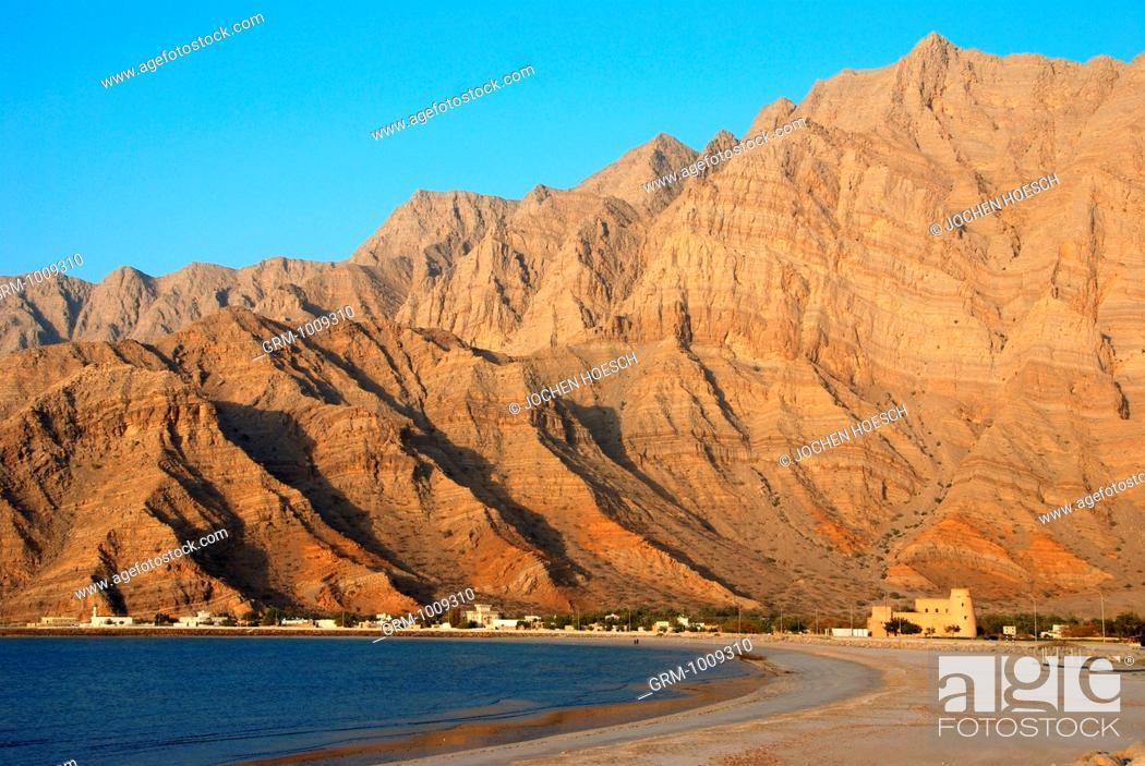 Stock Photo: Coast on Musandam with Bukha fort, Oman.