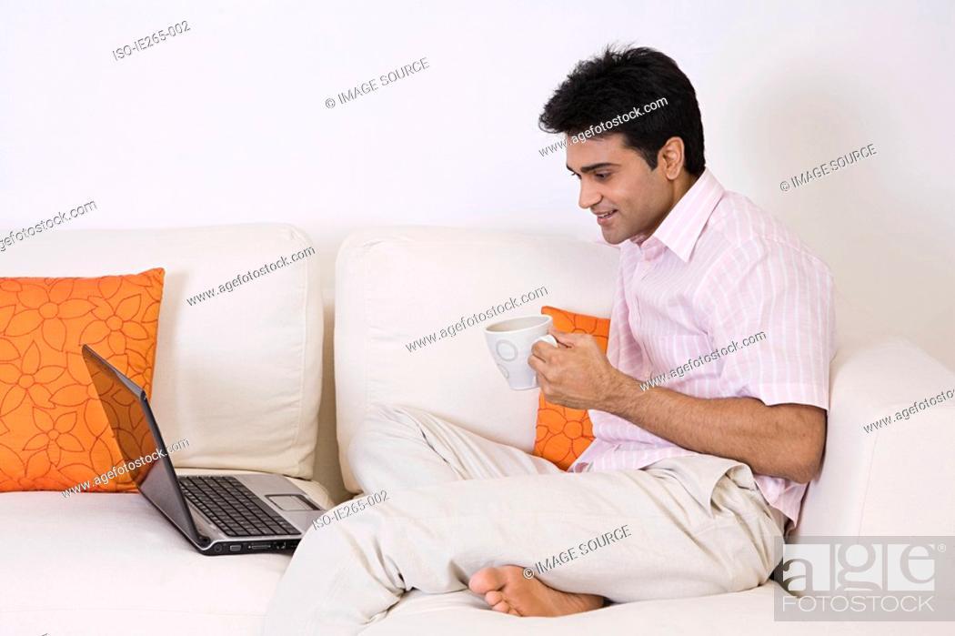 Stock Photo: Man using a laptop.
