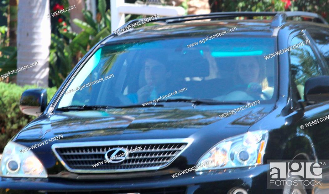 Calista Flockhart and her son driving about in Brentwood as