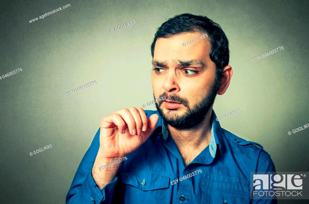 Stock Photo: Portrait of the shocked bearded man.