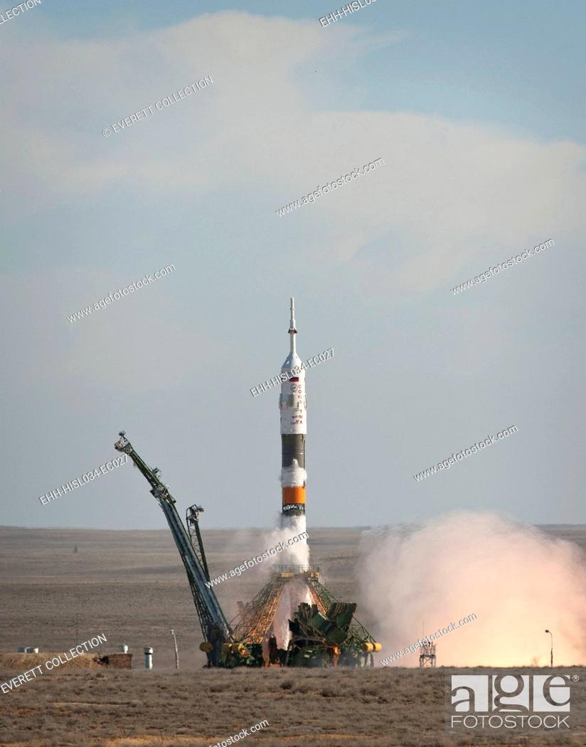 Stock Photo: The Soyuz TMA-18 rocket launches from the Baikonur Cosmodrome in Kazakhstan. It carried an international crew of the Expedition 30 to the International Space.