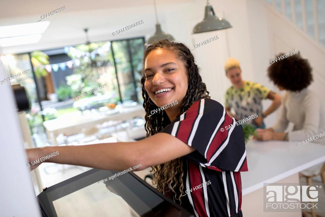 Stock Photo: Portrait happy young woman cooking kitchen.