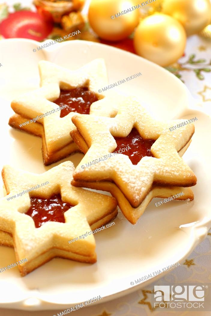 Stock Photo: Christmas cookies on plate and Christmas ornaments.