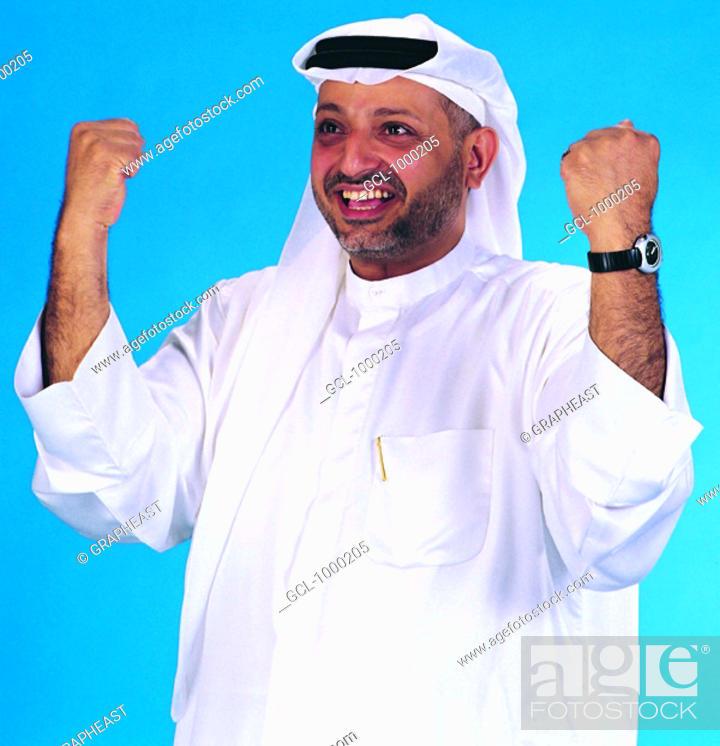 Stock Photo: Arab man in winning pose.