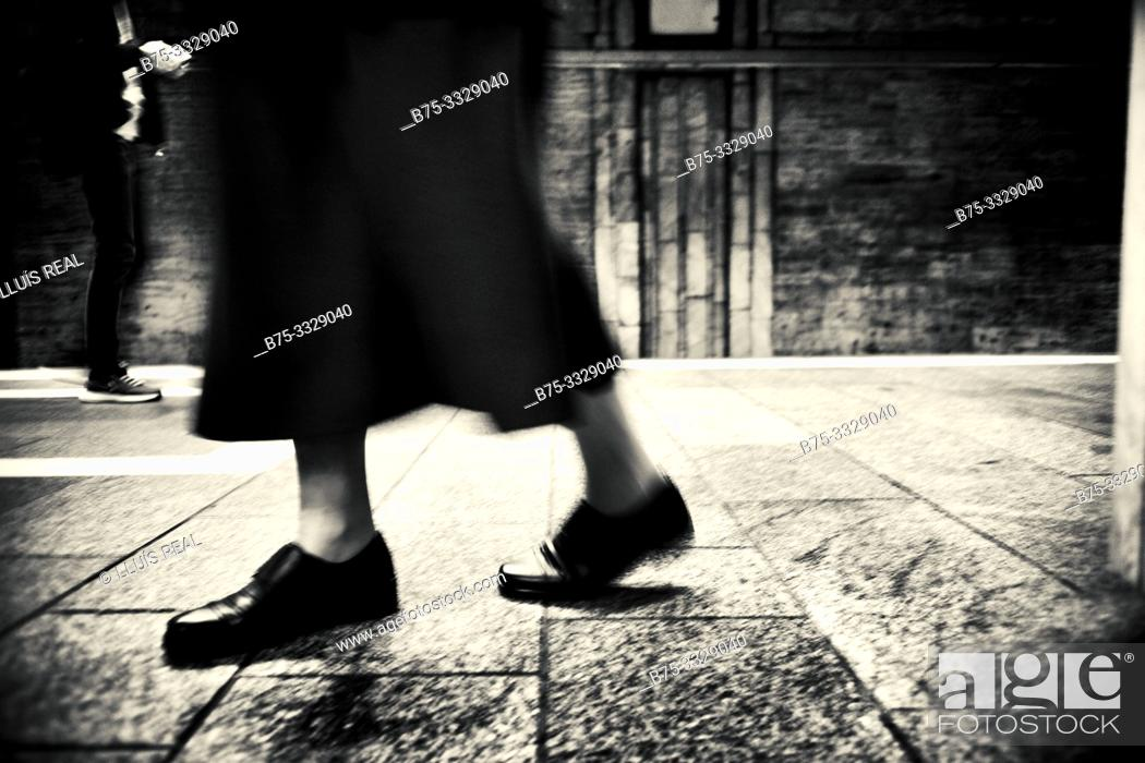 Stock Photo: Closeup of the feet of an old lady walking. Bucharest, Romania, Europe.