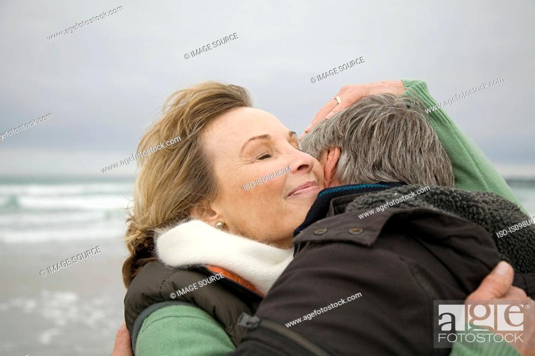 Stock Photo: Mature couple hugging at the coast.