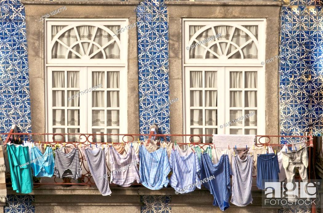 Stock Photo: laundry hanging from window ,typical quarter of Ribeira, Porto, Portugal.
