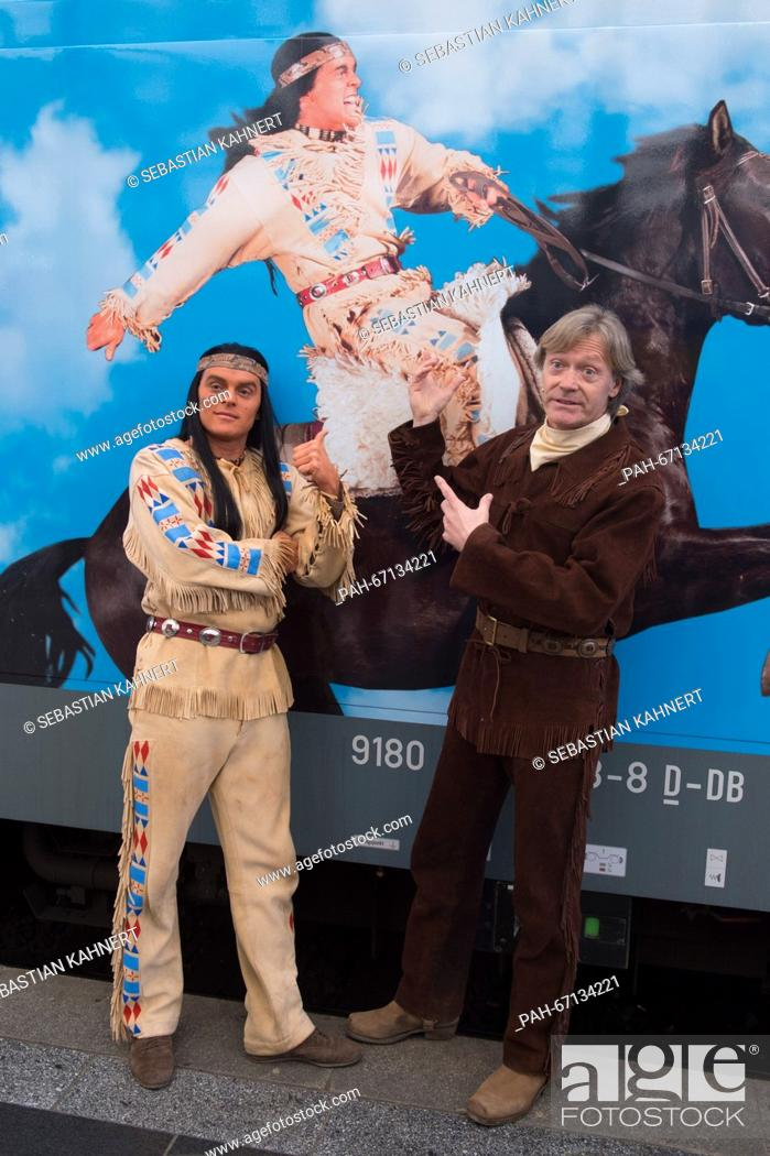 Stock Photo: Actor Michael Berndt-Canana (L) as Winnetou and Juergen Haase as Old Shatterhand pose in front of a class 146 locomotive at the central railway station in.
