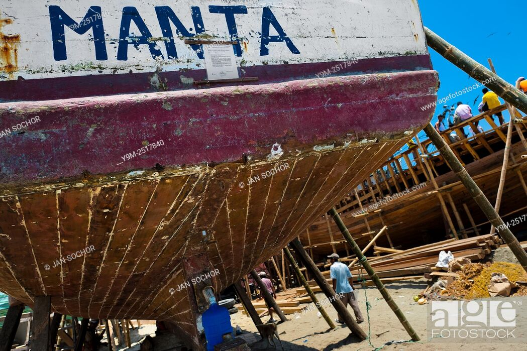 Stock Photo: The stern of a traditional fishing wooden vessel is seen being repaired in an artisanal shipyard on the beach in Manta, Ecuador, 9 September 2012.