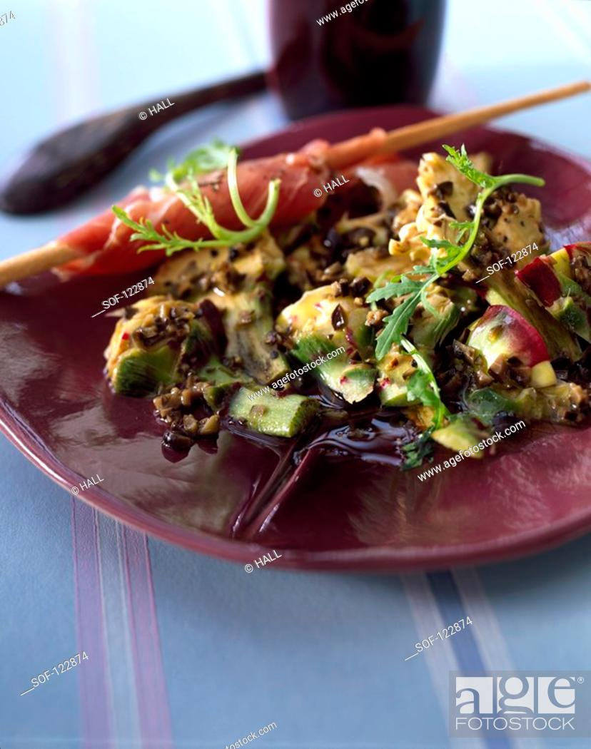 Stock Photo: Artichoke Carpaccio with black olive caviar.