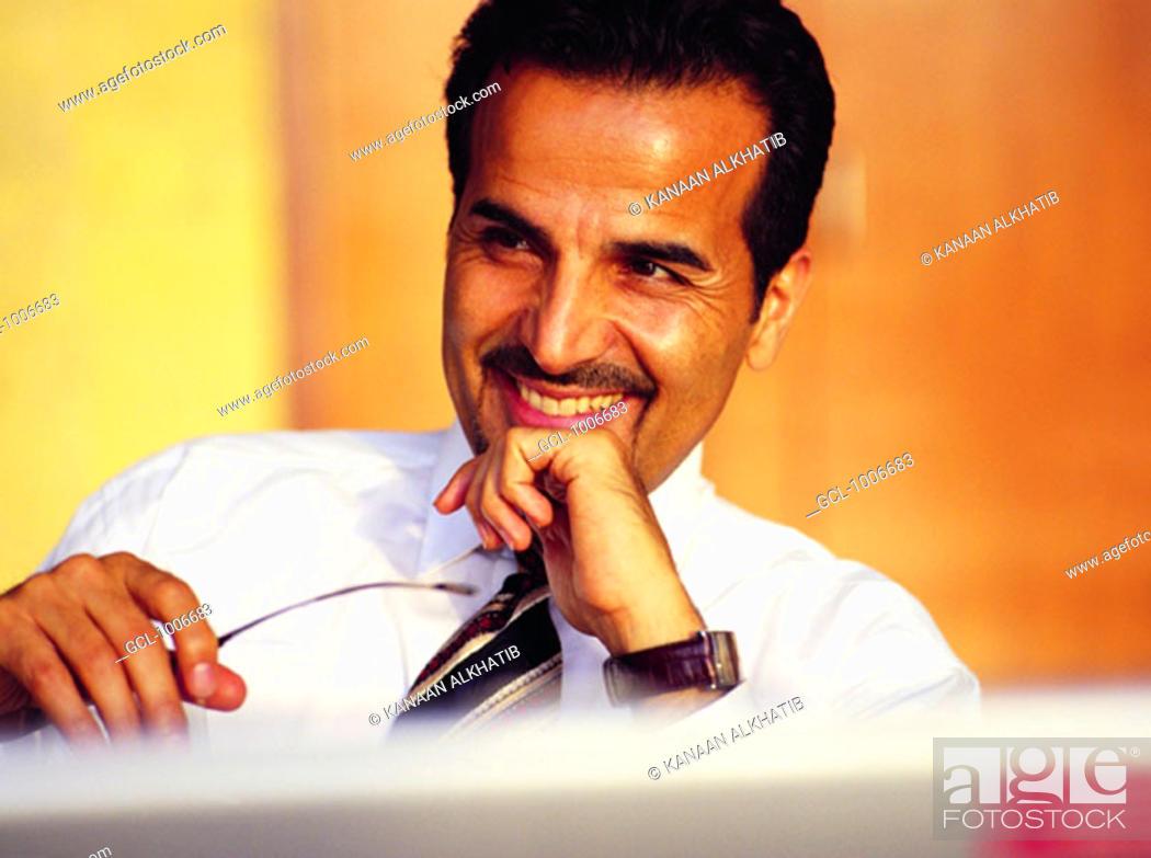 Stock Photo: Arab businessman smiling.