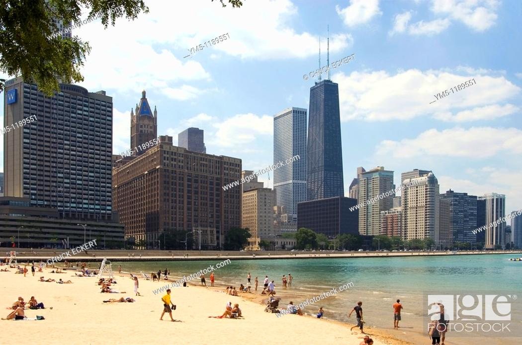 Stock Photo: Chicago's Ohio St Beach & Skyline. Tallest building is the John Hancock Center on Michigan Avenue. This beach is sometimes prone to closings due to storm.