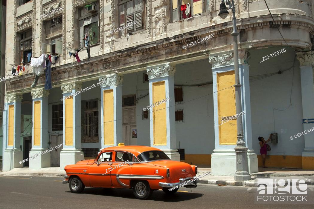 Stock Photo: Old American cars used as taxi in front of the colonial buildings in Central Havana, La Habana, Cuba, West Indies, Central America.
