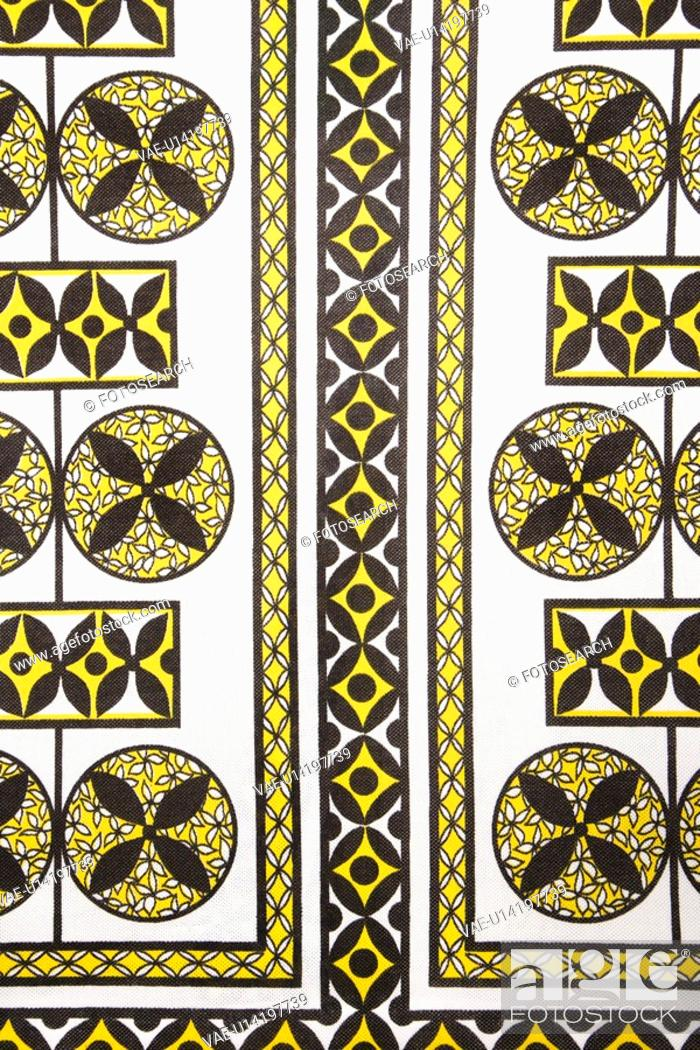 Stock Photo: Close-up of vintage fabric with black and yellow shapes and patterns printed on polyester.