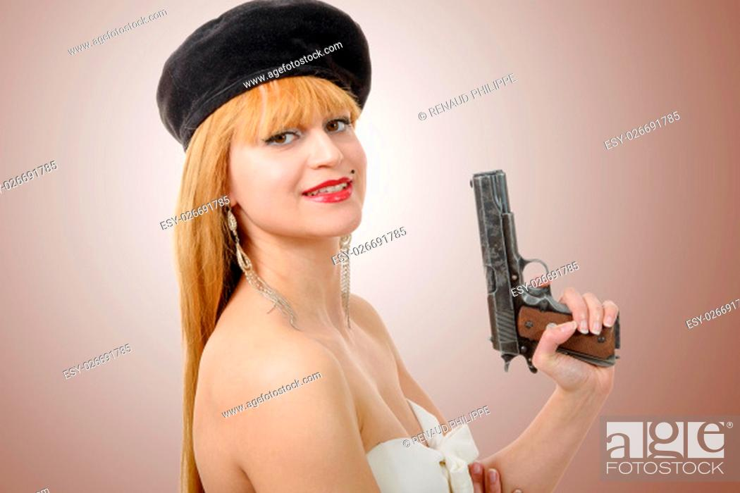 Stock Photo: a pretty young sexy woman with a gun.