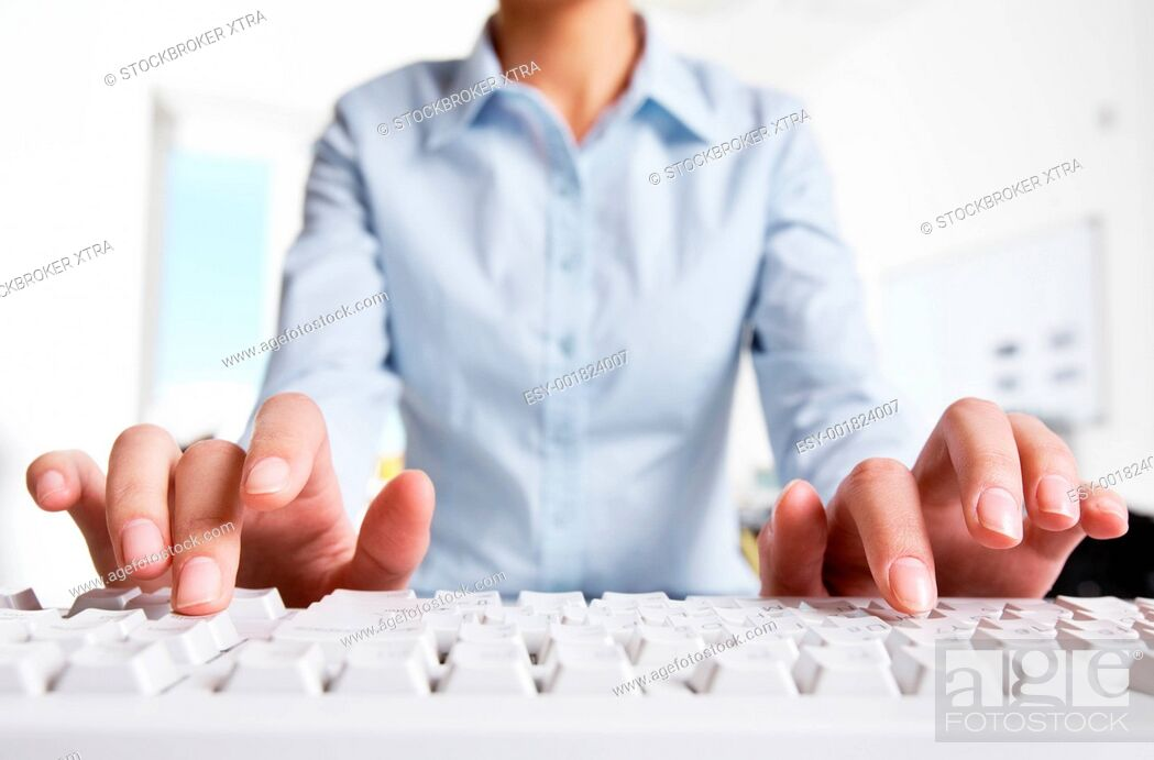 Stock Photo: Photo of woman's hands typing on keyboard in the office.