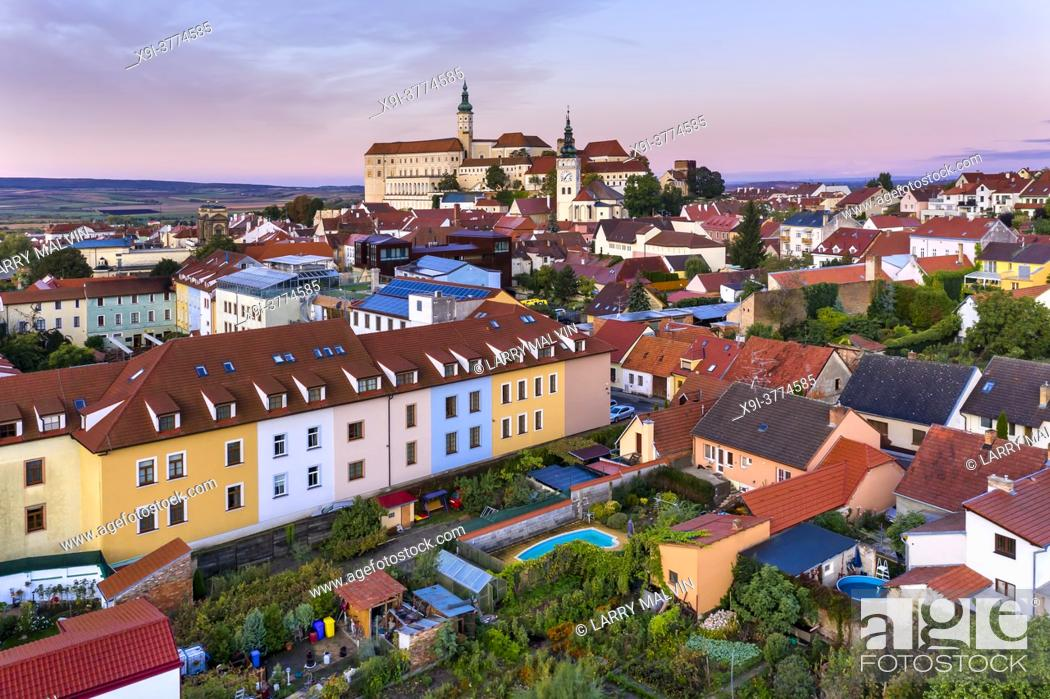 Stock Photo: Aerial view of the Mikulov Castle and Chateau at dawn in the South Moravia town of Mikulov in the Czech Republic.