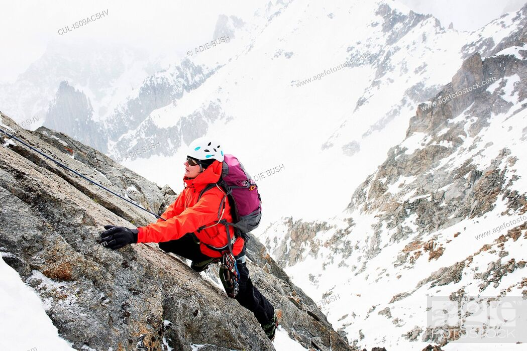 Stock Photo: Mid adult woman mountain climbing, Chamonix, France.