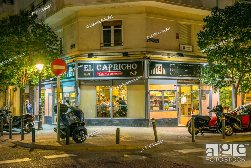 Stock Photo: Facade of El Capricho, typical tavern, night view. Lope de Rueda street, Madrid, Spain.