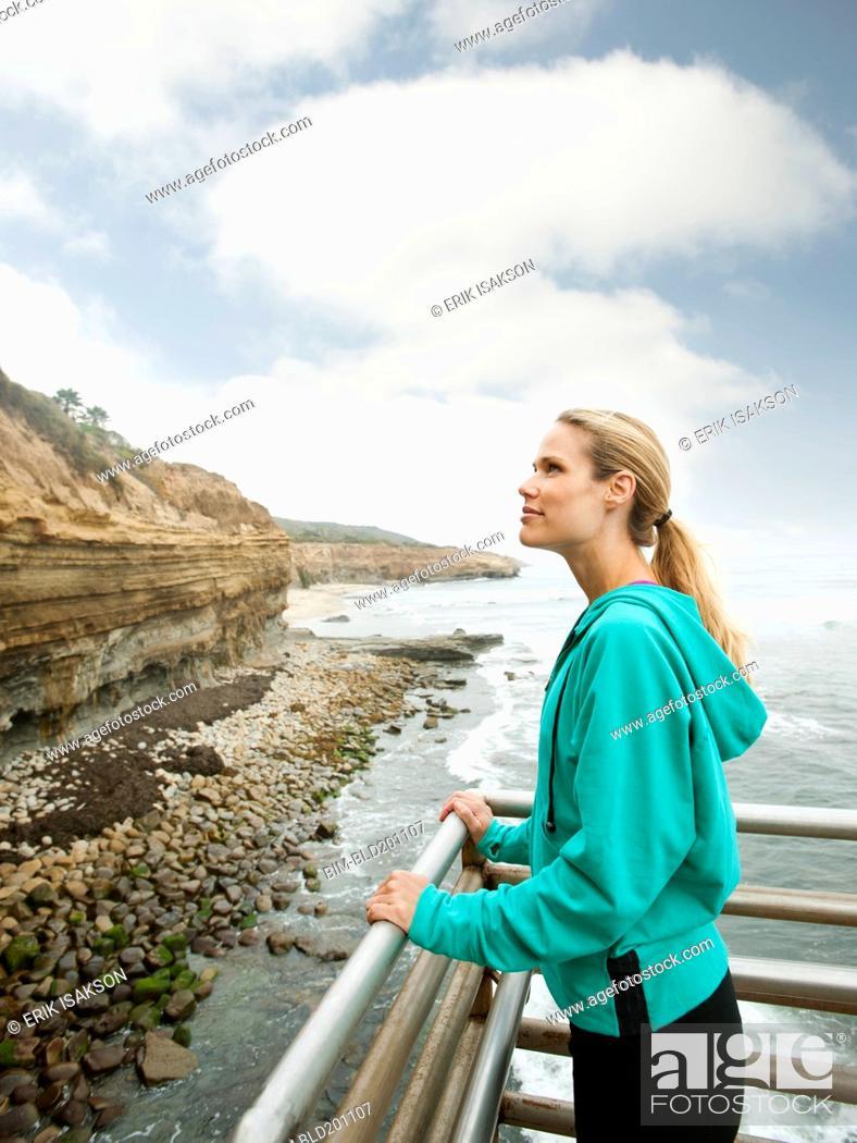 Stock Photo: Caucasian woman standing near ocean.