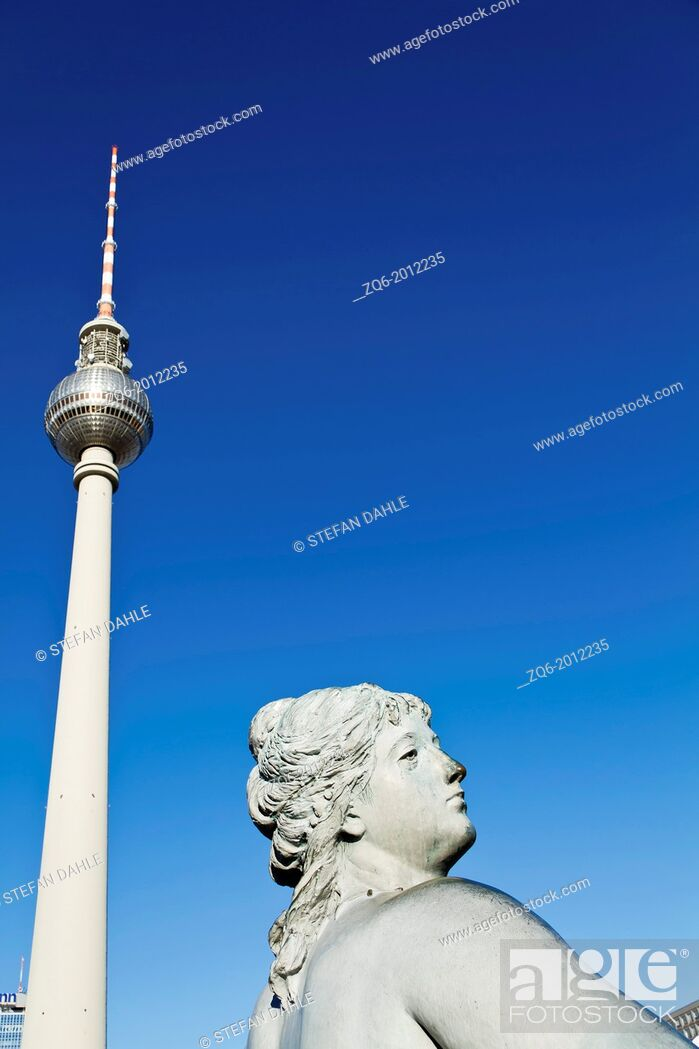Stock Photo: Statue of the Neptun Fountain and TV Tower on Alexanderplatz in Berlin, Germany.