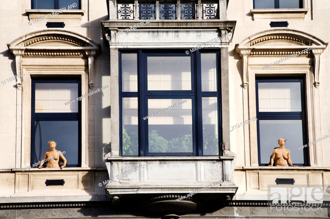 Stock Photo: Balcony Sculptures on Avenue Palmerston near Square Ambiorix Bru.