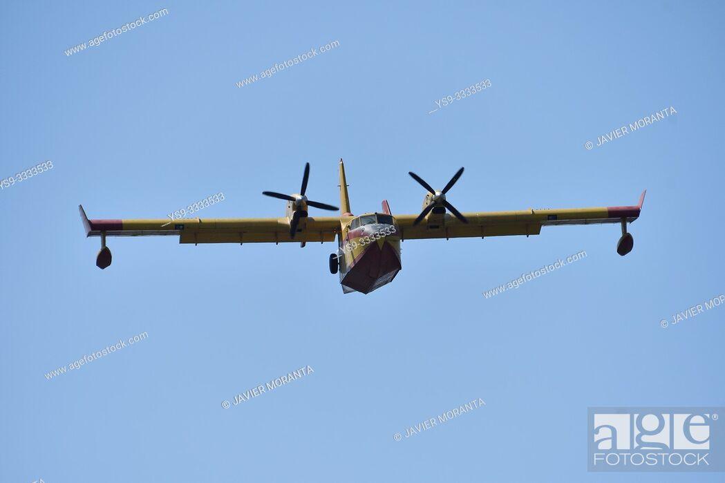 Stock Photo: Canadair plane performing fire training maneuvers in Cala Clara, Sant Vicens, Mallorca, Balearic Islands, Spain.