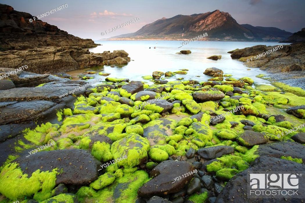 Stock Photo: Cove in Sonabia, Montaña Oriental Costera in background. Castro Urdiales, Cantabria, Spain.