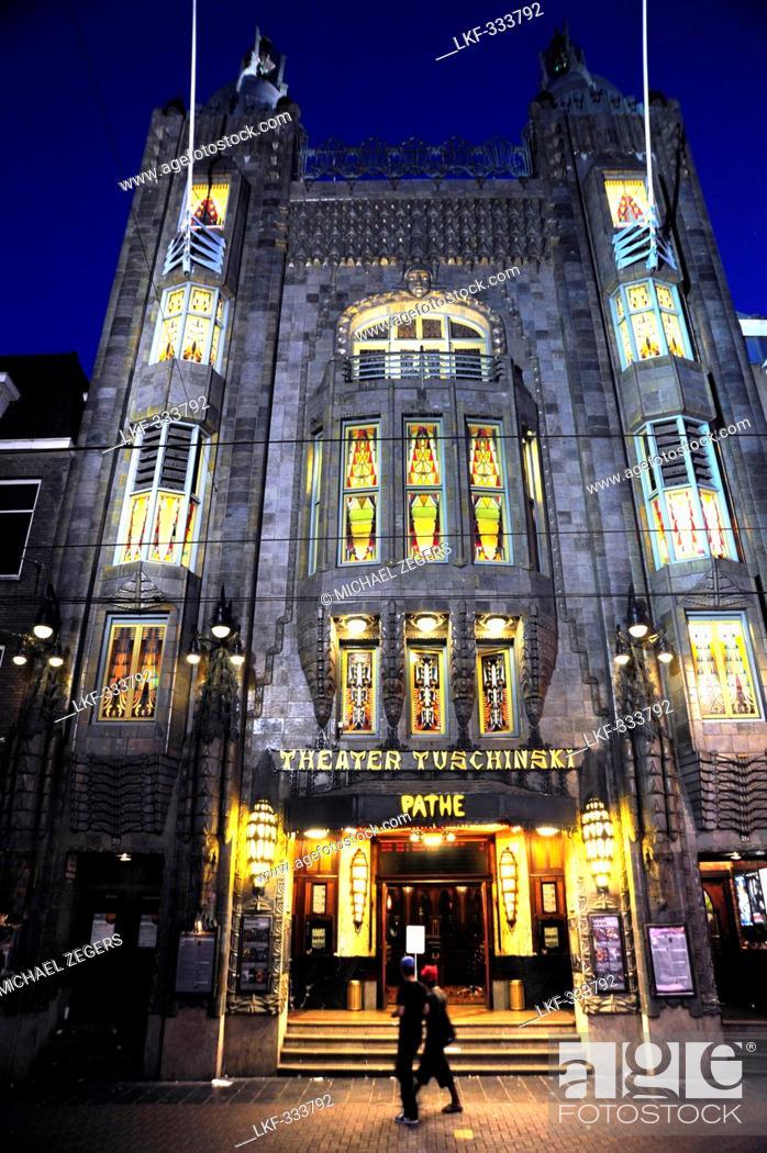 Stock Photo: Illuminated Tuschinski Theater, Pathe Cinemas, Art deco cinema, entrance at Reguliersbreestraat, Amsterdam, the Netherlands, Europe.