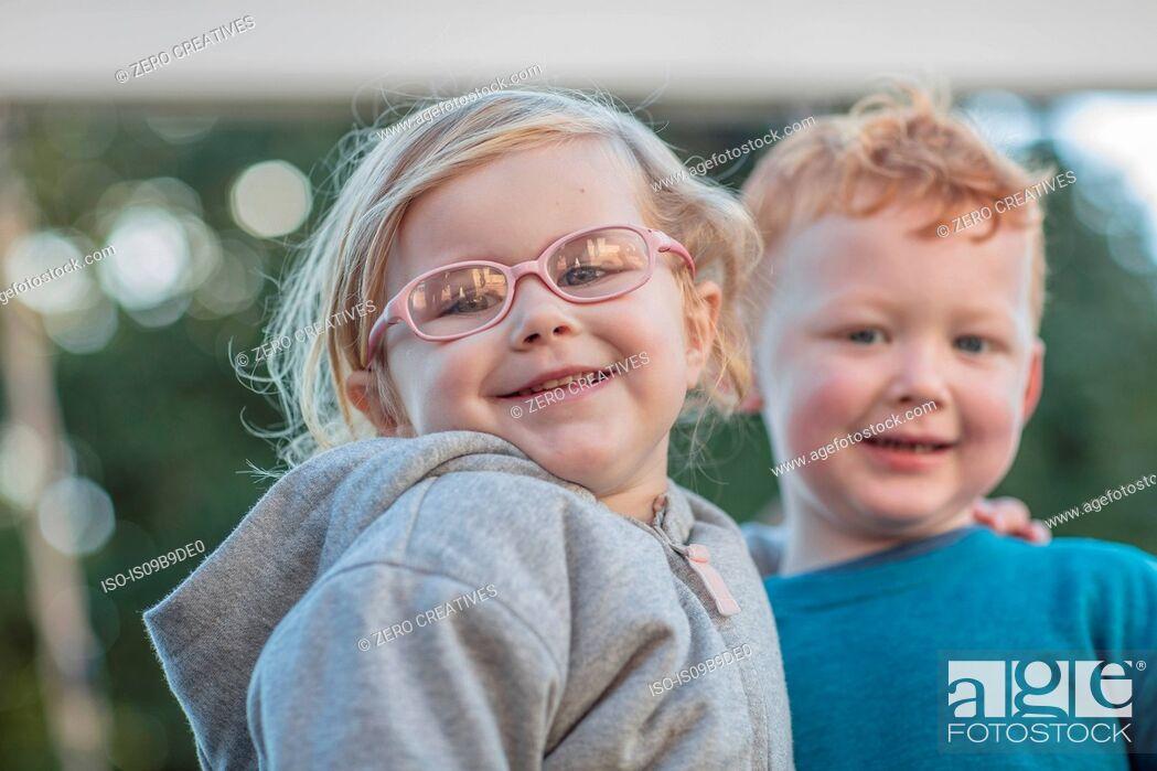 Photo de stock: Girl and boy at preschool, portrait in garden.