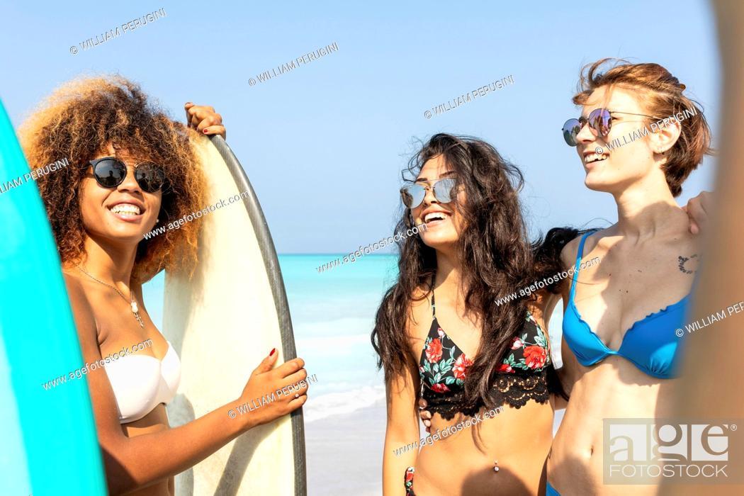 Stock Photo: Girl friends having fun on the beach.