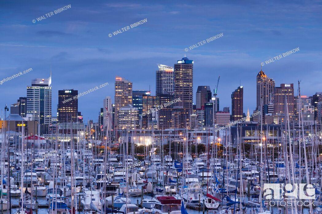 Stock Photo: New Zealand, North Island, Auckland, skyline from Westhaven Marina, dusk.